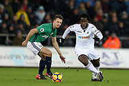 Wilfried Bony of Swansea city breaks away from Jonny Evans of West Bromwich Albion (l).  Premier league match, Swansea city v West Bromwich Albion at the Liberty Stadium in Swansea, South Wales on Saturday 9th December 2017.<br /> pic by  Andrew Orchard, Andrew Orchard sports photography.