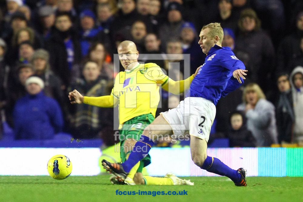 Picture by Paul Chesterton/Focus Images Ltd.  07904 640267.17/12/11.Marc Tierney of Norwich and Tony Hibbert of Everton in action during the Barclays Premier League match at Goodison Park Stadium, Liverpool.