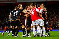 20111227: LONDON, UK - Barclays Premier League 2011/2012: Arsenal vS Wolverhampton Wanderers.<br /> In photo: Arsenal and Wolverhampton Wanderers players clash after Nenad Milijas of Wolverhampton Wanderers received a red card.<br /> PHOTO: CITYFILES