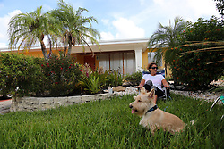 Carol Schumacher, who plans to ride out the storm with her husband, Bob, and dog Casey in their Lauderdale-By-The-Sea home, sits in a lawn chair in her front yard as her husband finished up Hurricane Irma preparation on Friday, Sept. 8, 2017.   (Amy Beth Bennett /Sun Sentinel/TNS/Sipa USA)<br />