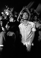 Nguu Cung, My Favorite Uncle and REGURGITATOR play at the CAMA festival. Vietnamese fans are entranced by the concert .American Club, Hai Ba Trung, Hanoi, Vietnam.