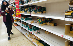 © Licensed to London News Pictures. 20/09/2020. London, UK. A woman wearing a face covering walks past empty shelves of pasta in a Sainsbury's supermarket in London, as essential items start to run out, amid a possible second lockdown due to a rise in COVID-19  cases. Photo credit: Dinendra Haria/LNP