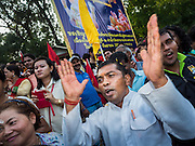 20 SEPTEMBER 2015 - SARIKA, NAKHON NAYOK, THAILAND: Men praise Ganesha at the river during the culmination of the Ganesh festival at Shri Utthayan Ganesha Temple in Sarika, Nakhon Nayok. Ganesh Chaturthi, also known as Vinayaka Chaturthi, is a Hindu festival dedicated to Lord Ganesh. Ganesh is the patron of arts and sciences, the deity of intellect and wisdom -- identified by his elephant head. The holiday is celebrated for 10 days. Wat Utthaya Ganesh in Nakhon Nayok province, is a Buddhist temple that venerates Ganesh, who is popular with Thai Buddhists. The temple draws both Buddhists and Hindus and celebrates the Ganesh holiday a week ahead of most other places.    PHOTO BY JACK KURTZ    PHOTO BY JACK KURTZ