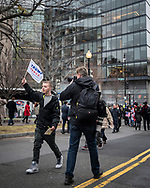 A photographer photographs a young Trump supporter.<br />