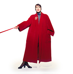 Nancy Norton modeling red coat off balance