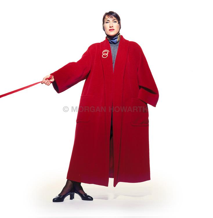 Nancy Norton modeling red coat off balance