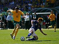 Photo: Glyn Thomas.<br />Australia v Japan. Group F, FIFA World Cup 2006. 12/06/2006.<br />Australia's John Aloisi (L) scores his team's third goal, past the despairing dive of Japanese defender Yuichi Komano.