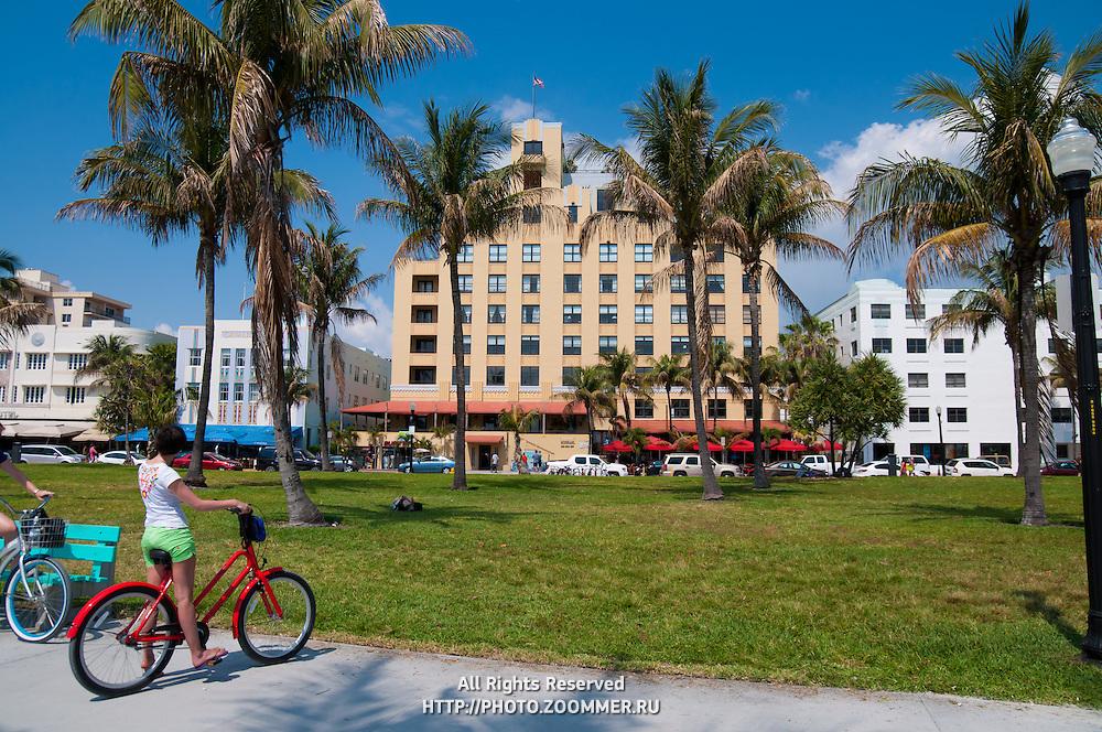 Girl on the bike on Ocean Drive, South Beach in Miami, Florida