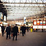 People inside Waterloo railway station, London, England in 1963