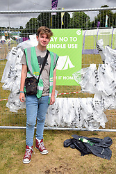 Latitude Festival, Henham Park, Suffolk, UK July 2019. Recycling volunteer in the campsite