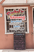 Sign advertising local food at a roadside food stall at Potter's Cay in Nassau, Bahamas.