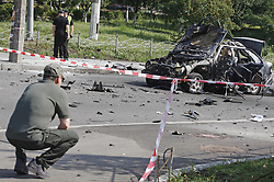 June 27, 2017 - Kiev, Ukraine - Police experts examine the wreckage of a car in Kiev, Ukraine, on June 27, 2017. Ukrainian media reported that a senior military intelligence officer has been killed in a car bomb in Ukrainian capital. (Credit Image: © Serg Glovny via ZUMA Wire)