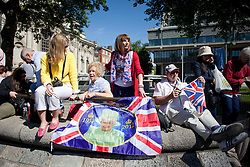 © Licensed to London News Pictures. 04/06/2013. London, UK. Royal fans and media are seen outside Westminster Abbey in London today (04/06/2013) as they wait the arrival of Her Majesty the Queen as she attends a service celebrating the anniversary of her coronation. Photo credit: Matt Cetti-Roberts/LNP
