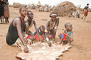 Africa, Ethiopia, Omo Valley, Curing leather Daasanach tribe