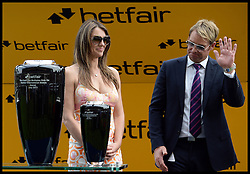 Liz Hurley with her partner Shane Warne present the winning prize for The cash out Multiples only on Betfiar International Stakes at Ascot Races<br /> Ascot Racecourse, Ascot, United Kingdom<br /> Saturday, 27th July 2013<br /> Picture by Andrew Parsons / i-Images<br /> <br /> According to British Media - Australian cricketer Shane Warne and British model Liz Hurley are rumoured to have split after the couple stopped using social media to communicate.<br /> Filed Tuesday 17 September, 2013.