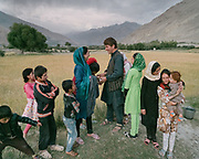Family of Khon Jon, after a visit to their ancestor's grave. In the village of Qala-e Panja, in the center of the Wakhan corridor. The traditional life of the Wakhi people, in the Wakhan corridor, amongst the Pamir mountains.