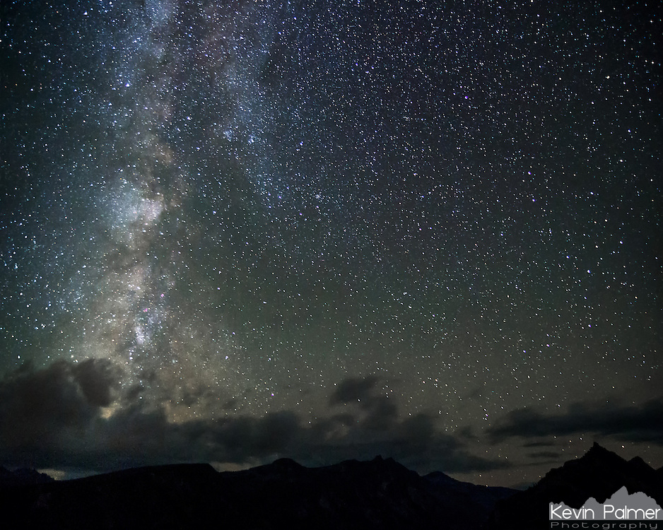 The milky way sets behind the peaks of the Biterroot Mountains, Montana. This view was seen from Lost Horse Overlook and the pointy peak on the right is Brandy Mountain. The clouds here were repeatedly forming in the same area on the left, hiding some of the milky way.