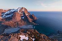 Storskiva mountain peaks rises over Bunes beach in light of the midnight sun, Moskenesøy, Lofoten Islands, Norway