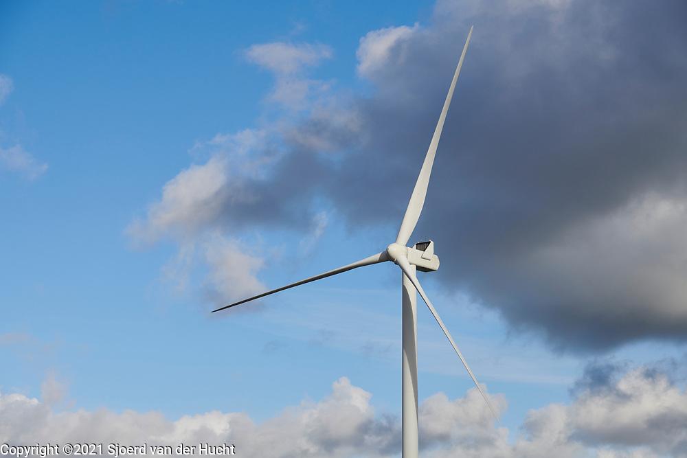 Windmill for generating green electricity through wind energy.   Windmolen voor het opwekken van groene stroom door windenergie.