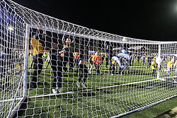 20 February 2017 - The FA Cup - (5th Round) - Sutton United v Arsenal - Sutton fans swing from the goal posts during a post match pitch invasion - Photo: Marc Atkins / Offside.