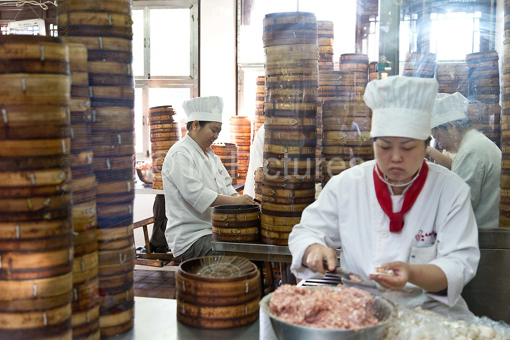 Old Town ShanghaiWorkers prepare and wrap Xiaolongbao at the Yuyuan Gardens in Shanghai, China on 13 October 2013. Xiaolongbao is one of the most famouse Shanghai food dishes and Yuyuan Garden claims to make the most original Xiaolongbao.