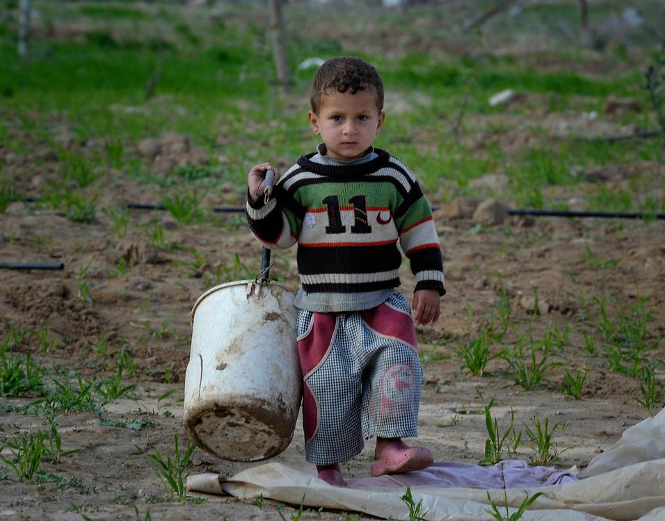 A child in Johor Al-Deek in the Bureij refugee camp in Gaza..