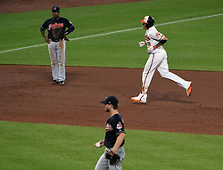 June 20, 2017 - Baltimore, MD, USA - The Baltimore Orioles' Manny Machado, top right, rounds the bases past Cleveland Indians infielder Jose Ramirez, top left, and pitcher Josh Tomlin after hitting a game-tying three-run home run in the fifth inning at Oriole Park at Camden Yards in Baltimore on Tuesday, June 20, 2017. The Orioles won, 6-5. (Credit Image: © Kenneth K. Lam/TNS via ZUMA Wire)