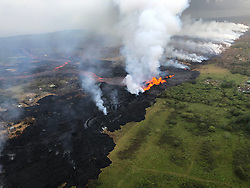 Handout photo taken on May 21, 2018 of KÄ«lauea Volcano — Aerial of Fissure 22. Aerial view of erupting fissure 22 and lava channels flowing southward from the fissure during an early morning overflight. View is toward the southwest. Photo by usgs via ABACAPRESS.COM