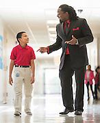 Eric Tingle and Mario Alvarado pose for a photograph at Foster Elementary School, February 12, 2015.