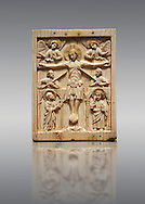 Medieval elephant ivory plaque with traces of paint made in Italy in the 13th or start of the 14th century.  The crucifixion is a rare example of a Gothic piece being inspired by 11th century Romanesque works.  inv 7268, The Louvre Museum, Paris. .<br /> <br /> If you prefer you can also buy from our ALAMY PHOTO LIBRARY  Collection visit : https://www.alamy.com/portfolio/paul-williams-funkystock/romanesque-art-antiquities.html . Type -   Louvre   - into the LOWER SEARCH WITHIN GALLERY box. Refine search by adding background colour, place, museum etc<br /> <br />  Visit our MEDIEVAL PHOTO COLLECTIONS for more   photos  to download or buy as prints https://funkystock.photoshelter.com/gallery-collection/Medieval-Romanesque-Art-Antiquities-Historic-Sites-Pictures-Images-of/C0000uYGQT94tY_Y