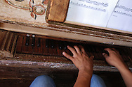 Young hands on the keyborard of Santa Ana de Velasco church's organ. Original of 18th century.