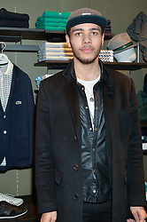 JOEL COMPASS at a party to celebrate the reopening of the Lacoste Premium Store at 233 Regent Street, London on 28th May 2014.