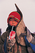 Jockey with saddle<br /> National winter horse race<br /> Jockey's aged 4-12 years and most often girls<br /> Ulaanbaatar race track<br /> Mongolia
