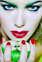 beautiful caucasian woman portrait holding apple witch concept studio