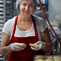 Sewickley, PA - September 17:  Staff members work early in the morning preparing food at Pierogies Plus in McKees Rocks, PA on September 17, 2018. (Photo by Shelley Lipton)