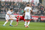 Kevin Stewart of Liverpool © falls under the challenge from Jack Cork of Swansea city (l). Barclays Premier league match, Swansea city v Liverpool  at the Liberty Stadium in Swansea, South Wales on Sunday 1st May 2016.<br /> pic by  Andrew Orchard, Andrew Orchard sports photography.
