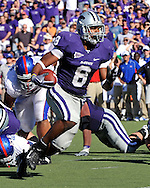 MANHATTAN, KS - NOVEMBER 07:  Running back Daniel Thomas #8 of the Kansas State Wildcats rushes up the middle en route for a 5-yard touchdown in the third quarter against the Kansas Jayhawks on November 7, 2009 at Bill Snyder Family Stadium in Manhattan, Kansas.  (Photo by Peter G. Aiken/Getty Images)