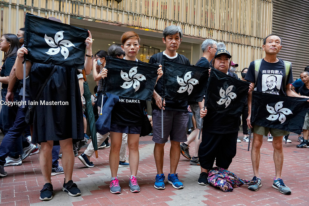 Hong Kong. 1 October 2019. Protestors at start of march with pro-democracy signs featuring black Hong Kong flag in Causeway Bay. Marchers were estimated at 100,000.  Violence later flared in the afternoon when protestors attacked police. Iain Masterton/Alamy Live News.