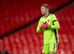 LONDON, ENGLAND - Thursday, October 8, 2020: Wales' goalkeeper Wayne Hennessey spits during the International Friendly match between England and Wales at Wembley Stadium. The game was played behind closed doors due to the UK Government's social distancing laws prohibiting supporters from attending events inside stadiums as a result of the Coronavirus Pandemic. England won 3-0. (Pic by David Rawcliffe/Propaganda)