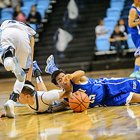 020415  Adron Gardner/Independent<br /> <br /> Window Rock Scouts Eric Sloan (23), left, tries to avoid Scout Jeremy Peshlakai (42) as Hopi Bruin Nell Silas (15) reaches for the ball at the Fighting Scout Event Center in Fort Defiance Wednesday.