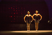 Two muscular men in tutus pose as part of a performance of Les Ballets Trockadero de Monte Carlo at Celebrate Brooklyn.