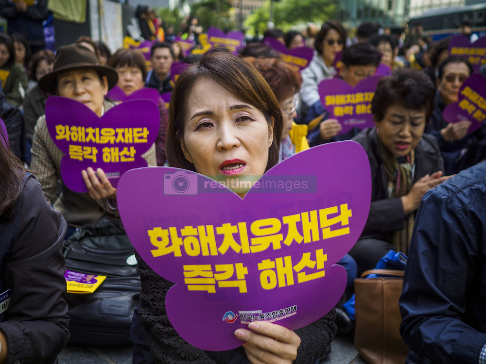 October 10, 2018 - Seoul, Gyeonggi, South Korea - Korean women wave placards during the Wednesday Demonstration to protest Japan's sexual enslavement of Korean women during World War II. The Wednesday protests have been taking place since January 1992. (Credit Image: © Jack Kurtz/ZUMA Wire)