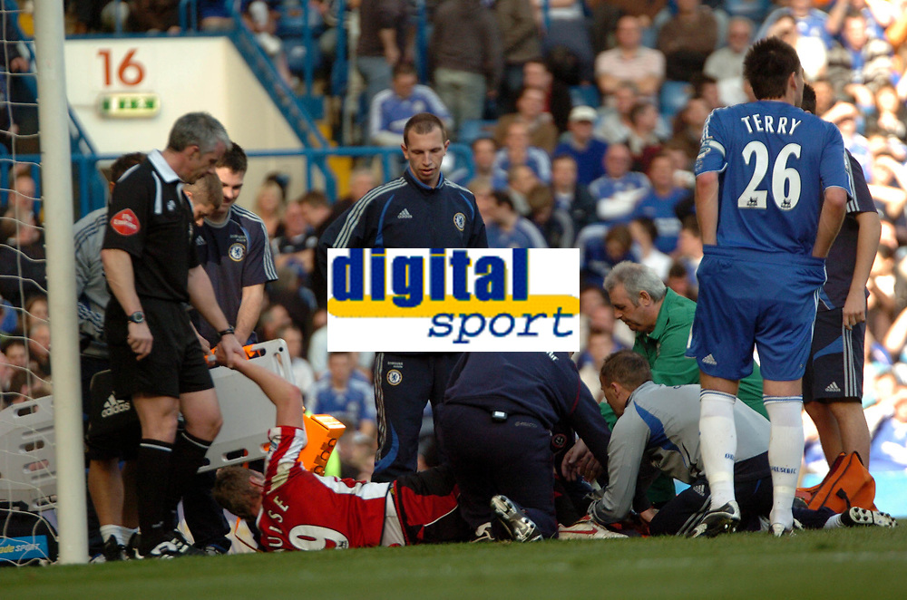 Photo: Tony Oudot.<br />Chelsea v Sheffield United. The Barclays Premiership. 17/03/2007.<br />Rob Hulse of Sheffield United is stretchered off with a suspected broken leg after colliding with Petr Cech.<br />The referee Chris Foy holds the hand of Rob Hulse as he lies injured