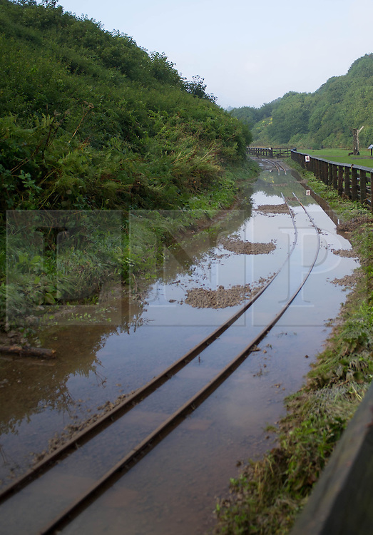 © Licensed to London News Pictures. 07/09/2013<br /> <br /> Saltburn, Cleveland, England<br /> <br /> Flood water covers railway tracks from the miniature railway following an evening of torrential rainfall that caused flooding and disruption to Saltburn in Cleveland.<br /> <br /> Photo credit : Ian Forsyth/LNP