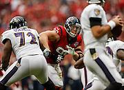 Oct 21, 2012; Houston, TX, USA; Houston Texans defensive end J.J. Watt (99) rushes Baltimore Ravens quarterback Joe Flacco (5) during the first half at Reliant Stadium. Mandatory Credit: Thomas Campbell-www.thomasgcampbell.com