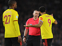 Football - 2019 / 2020 Premier League - Brighton & Hove Albion vs. Watford<br /> <br /> Referee Kevin Friend in conversation with Watford's Troy Deeney, at the Amex Stadium.<br /> <br /> COLORSPORT/ASHLEY WESTERN