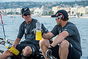 Emirates Team New Zealand sailors Peter Burling and Glenn Ashby catch a breath and have a quick debrief between races on day four of the Extreme Sailing Series Regatta at Nice. 5/10/2014