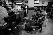 Carlos goes through the change in his pocket to see if he has enough for a beer at the Atletico club in Fall River. His father, sitting in front of him, ends up buying him a beer and a sandwich. Carlos Raposa, 49, has lived with diabetes since he was 21 years old. Due to some complications heightened by the disease, Mr. Raposa lost both legs below the knees.  As his condition has worstened over the years Carlos has had greater difficulty dealing with his condition.  Increasingly, Carlos has fallen greater into depression and has turned to smoking and drinking to deal with it.  What used to be monthly visits to the hospital has turned into weekly excursions with ever longer stays in hospital.  Family members have become ever more worried about Carlos' drop in weight and his inability to move on his own any longer.  For someone who was an athletic figure, Carlos has become a shadow of his former self.