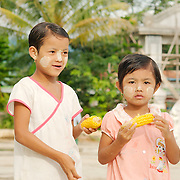 Two Burmese girls with tanaka on their faces