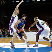 Anadolu Efes's Stratos Perperoglou (C) and Unicaja Malaga's Caleb Green (R) during their Turkish Airlines Euroleague Basketball Top 16 Round 2 match Anadolu Efes between Unicaja Malaga at Abdi ipekci arena in Istanbul, Turkey, Friday January 09, 2015. Photo by Aykut AKICI/TURKPIX